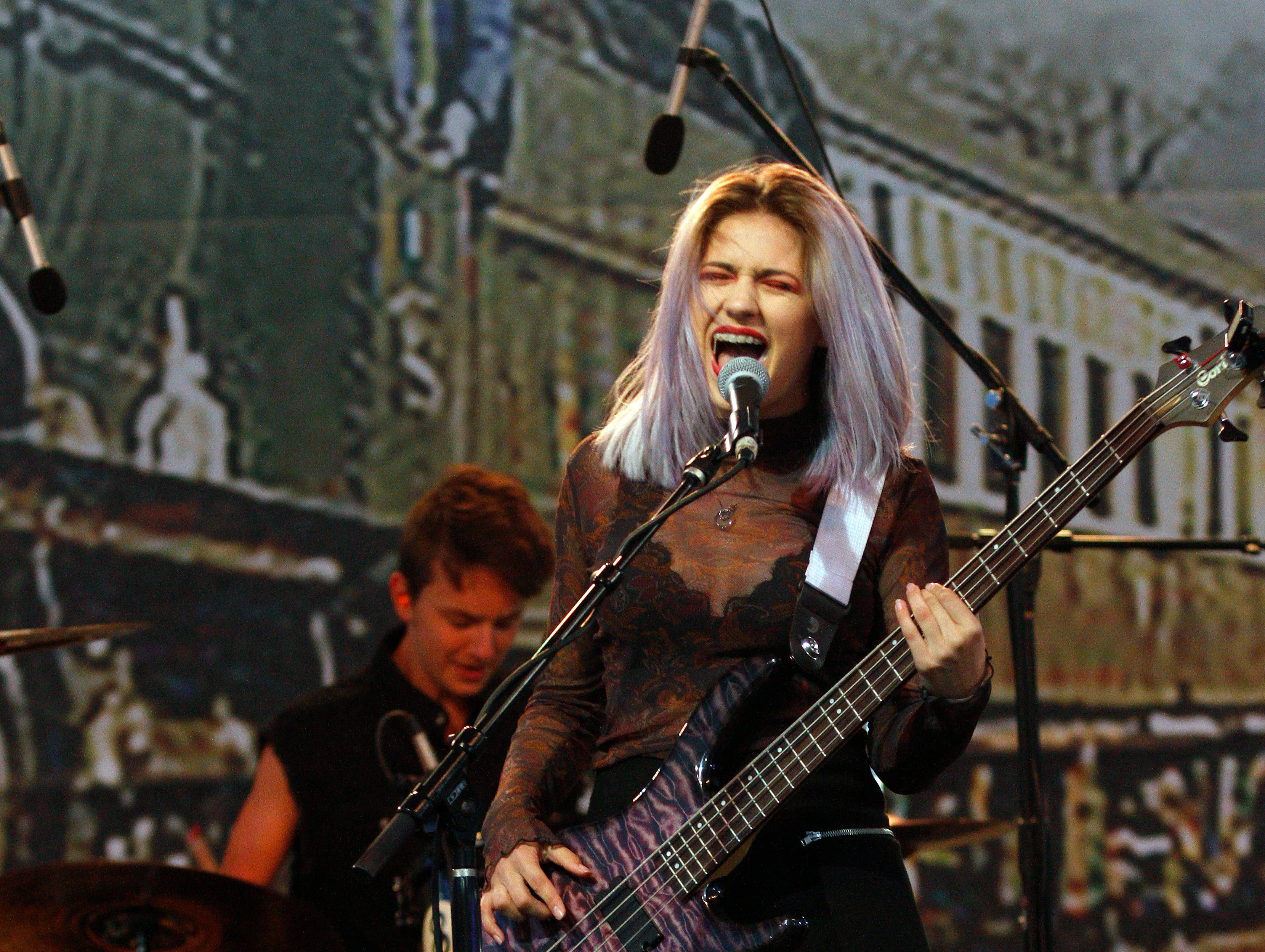 Singer and bassist Ellison Thomason performs with the band Stereo Fidelity  during the opening night of the four-day Conejo Valley Days festival in Thousand Oaks on Thursday.