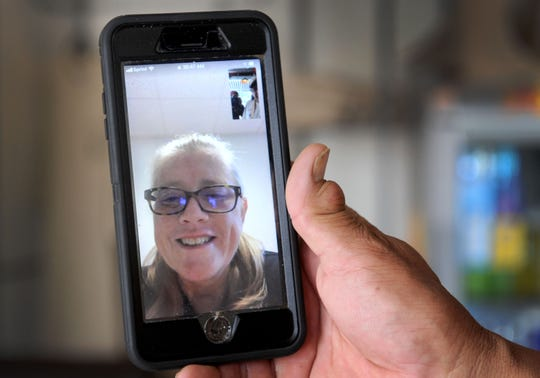 Misty Romero is seen on a cell phone screen as husband Ernest Romero FaceTimes her from the dining room of their Ventura restaurant, J Wolf Catering & BBQ. Misty is recovering from open-heart surgery related to damage caused by three successful battles with cancer.