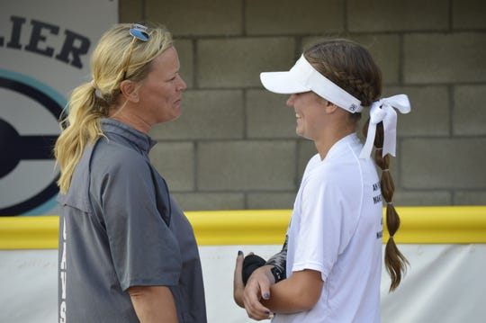 Central Valley Christian softball head coach Cindy Atherton, left, and her daughter, Rylie, share a moment after the Cavaliers defeated California City on Thursday in a playoff game.