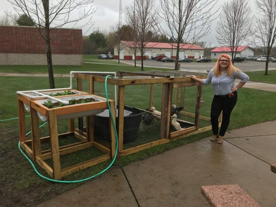 Bailey Bootz shows off her quaquaponics project, complete with ducks, Thursday, May 9, 2019, during the Wausau Engineering and Global Leadership Academy's Project Showcase at Wausau East High School.