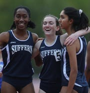 From left Suffern's Monal Daterao, Mary Hennelly and Annelyse Benn celebrate the second fastest time clocked this spring by New York high school girls to win the girls East Coast challenge sprint medley relay in 4:05.63 during Day 1 of Loucks Games at White Plains High School May 9, 2019.  Sarah Galvin the fourth member of the relay team ran the first leg.