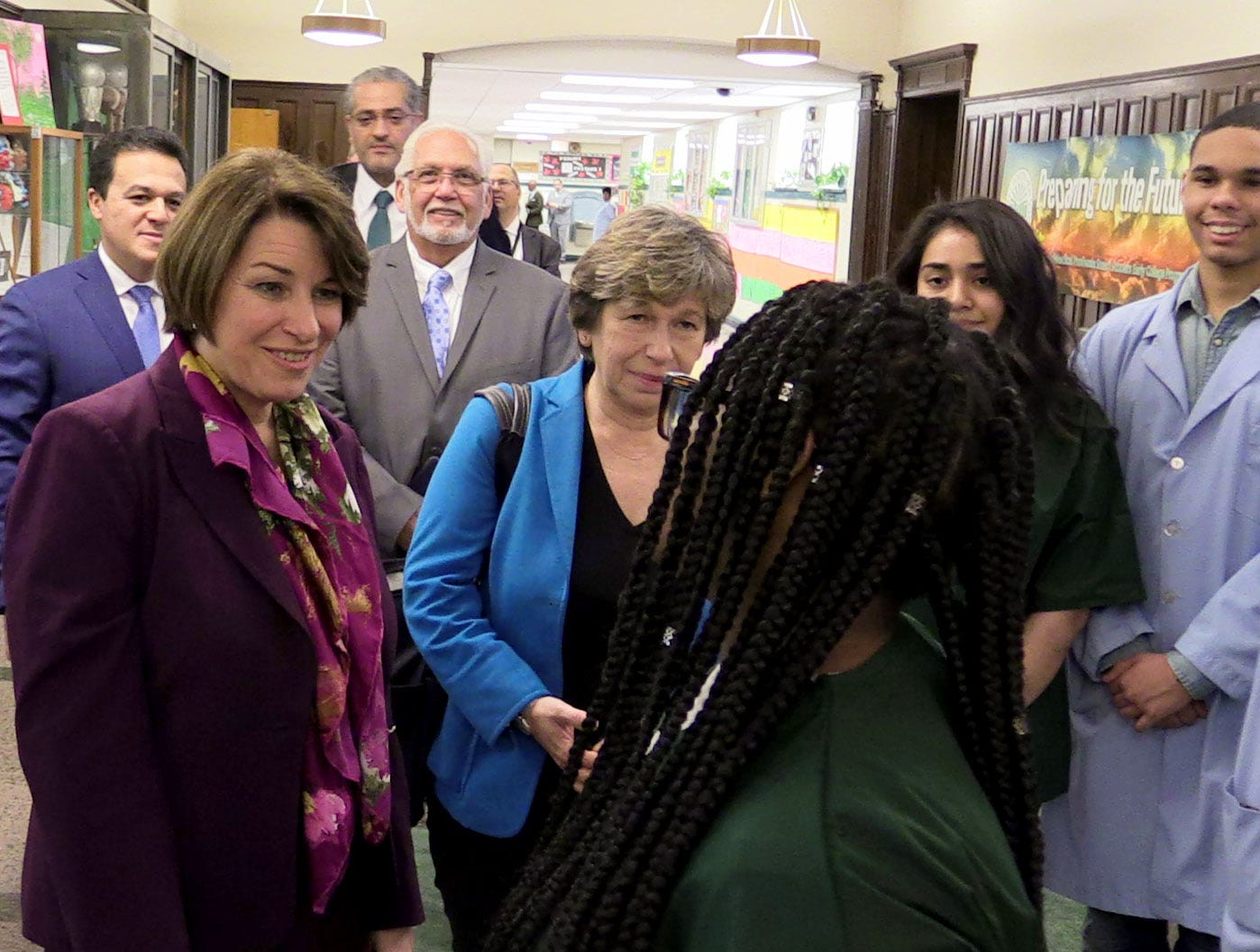 U.S. Sen. Amy Klobuchar (D-Minn.), a Democratic presidential candidate, along with Randi Weingarten, the president of the American Federation of Teachers, greets students in the vestibule of Gorton High School in Yonkers, May 10, 2019. She was there for a tour of the school.