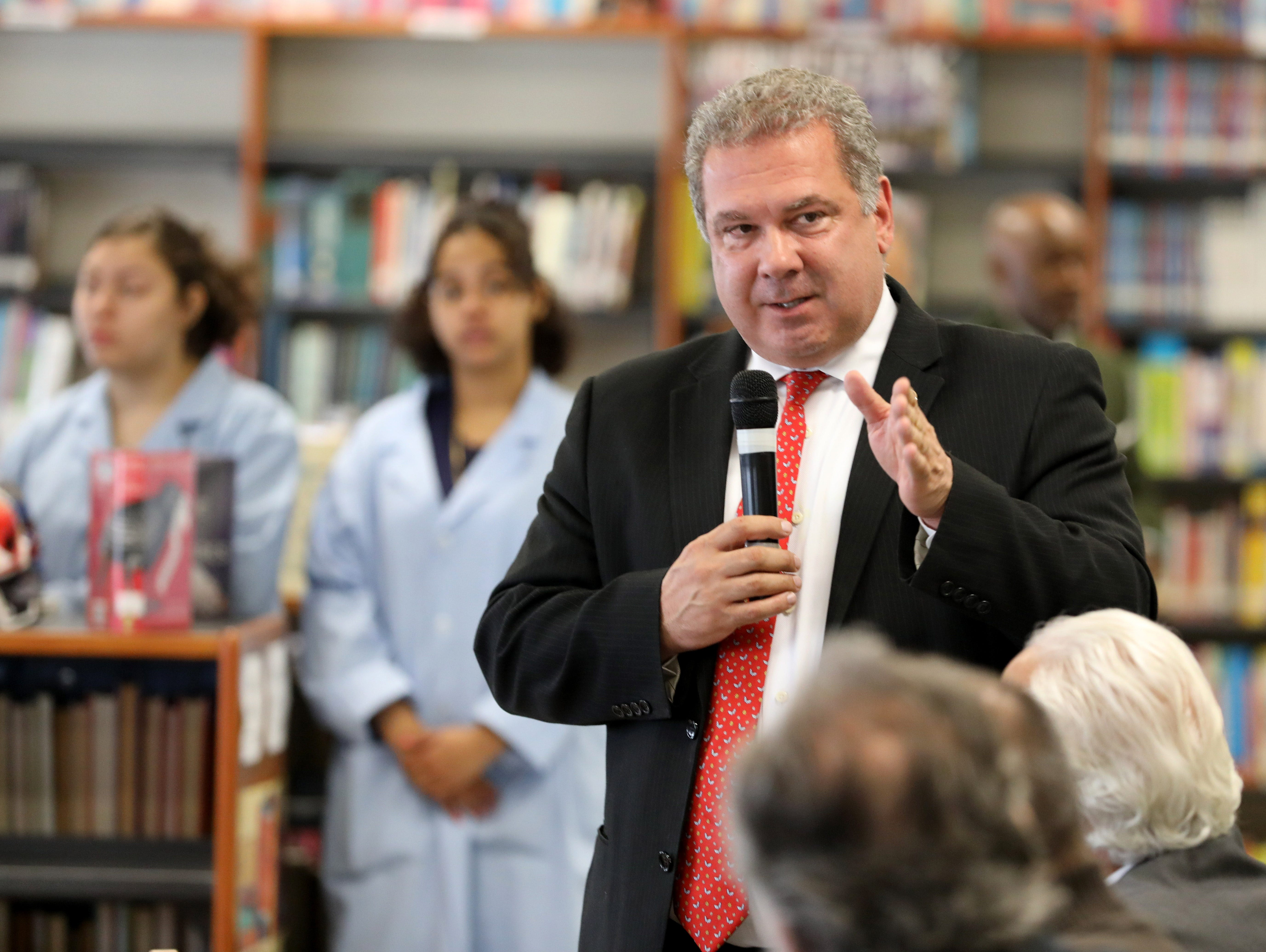 Yonkers Mayor Mike Spano welcomes U.S. Sen. Amy Klobuchar (D-Minn.), a Democratic presidential candidate, to Gorton High School in Yonkers, May 10, 2019.
