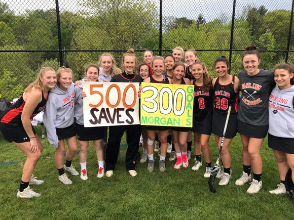 Pawling sophomore goalie Sara Corbi celebrates 500th saves and junior Morgan McCarthy celebrates her 300th career goal with their teammates after Pawling defeated Hastings May 9, 2019.