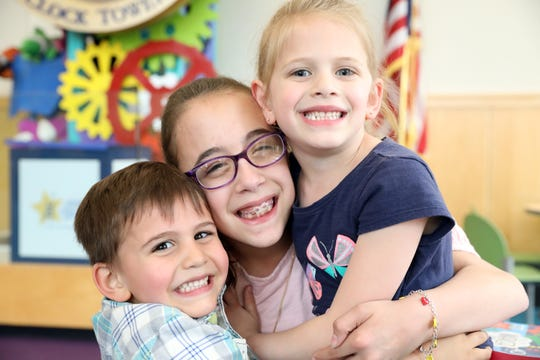 Tess Ranieri, 10, who was born at 25 weeks, with her sister Grace, 5, and brother Jack, 4, at Maria Fareri Children's Hospital May 9, 2019 in Valhalla. Their mother, Patti Ranieri, volunteers at Maria's Hope, a program helping new moms of micro preemies to navigate an emotional, scary time.