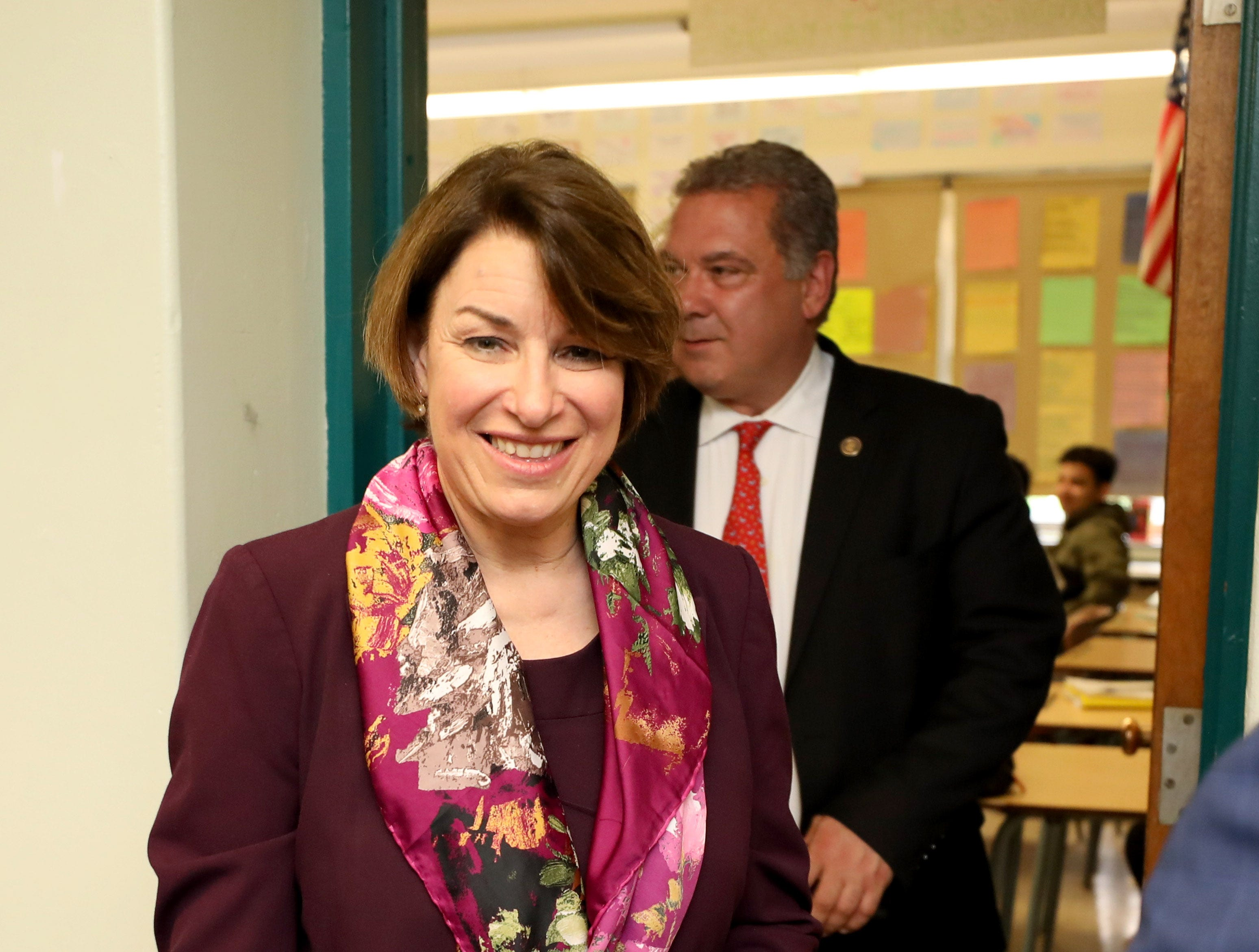 U.S. Sen. Amy Klobuchar (D-Minn.), a Democratic presidential candidate, leaves a classroom at Gorton High School in Yonkers, followed by Yonkers Mayor Mike Spano, during a tour of the school May 10, 2019.