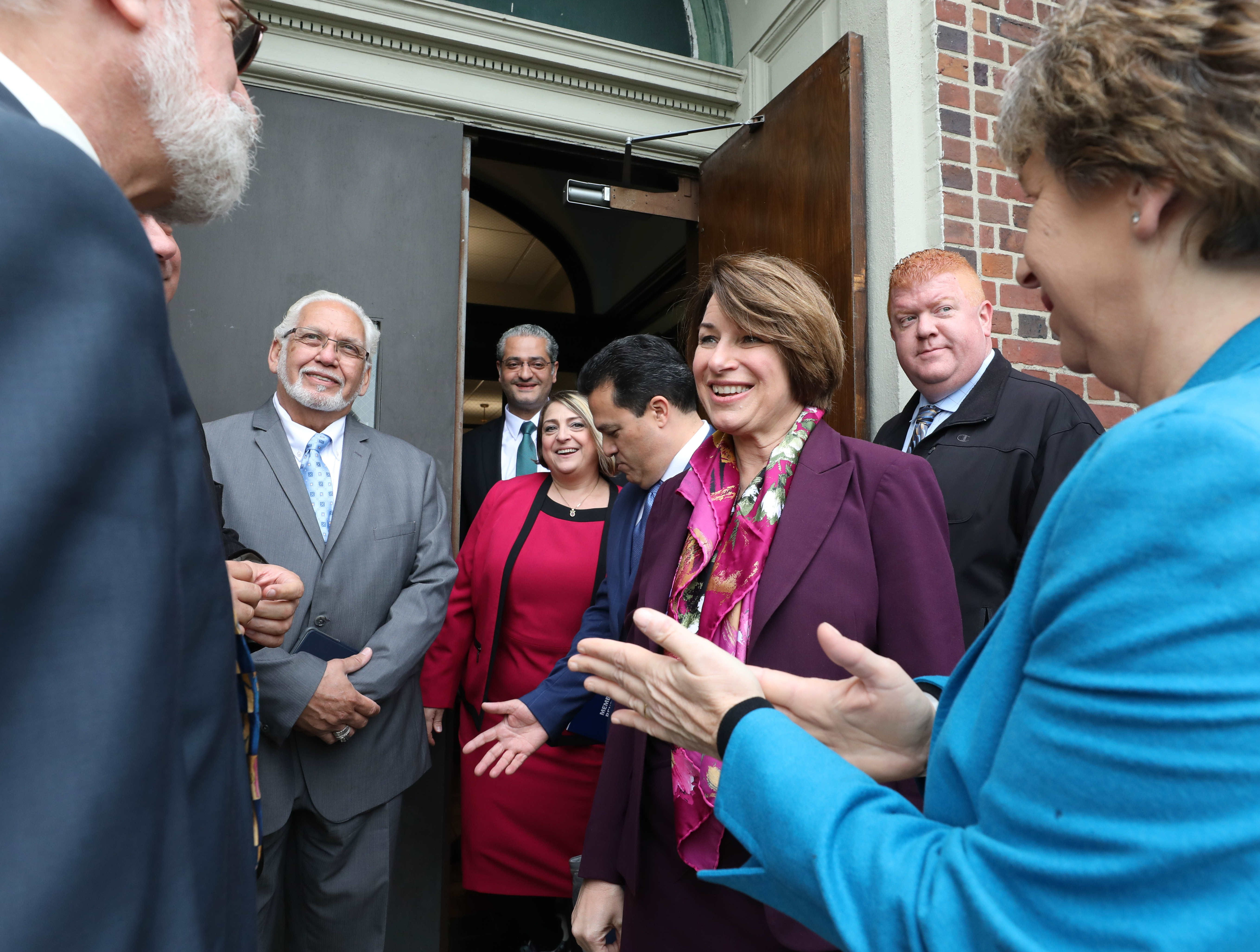U.S. Sen. Amy Klobuchar (D-Minn.), a Democratic presidential candidate, greets invited guests outside of Gorton High School in Yonkers, May 10, 2019. She was there for a tour of the school.