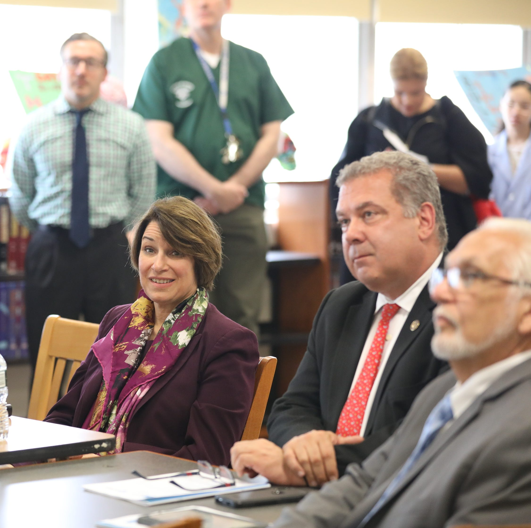 U.S. Sen. Amy Klobuchar, center, and Randi Weingarten, president of the American Federation of teachers left, attend a meeting at Gordon high school in Yonkers.
