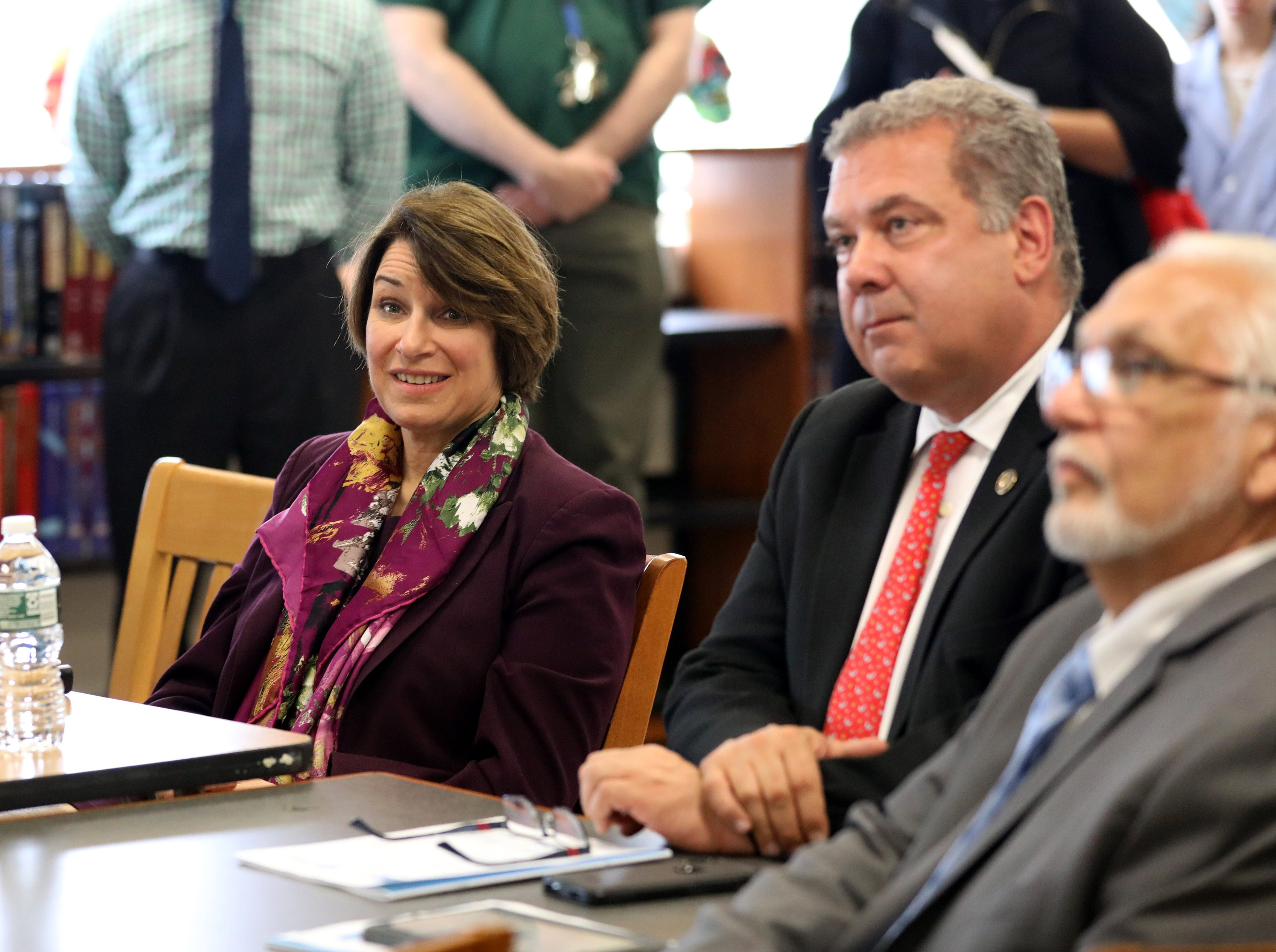 Randi Weingarten, left, the president of the American Federation of Teachers; U.S. Sen. Amy Klobuchar (D-Minn.), a Democratic presidential candidate; Yonkers Mayor Mike Spano and Rev. Steve Lopez, the President of the Yonkers Board of Education, attend a school tour at Gorton High School in Yonkers, May 10, 2019.