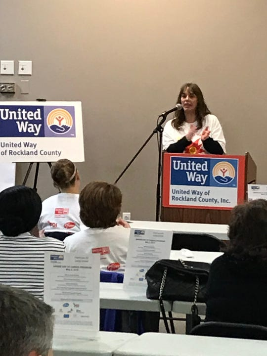 Dana Treacy, President & CEO of United Way of Rockland, welcomes volunteers, sponsors, nonprofits and elected officials to the 2019 Spring Day of Caring Kick-off Luncheon & Rally at the Palisades Center.