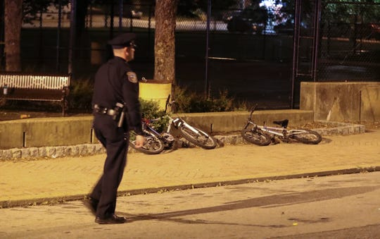 Bicycles are abandoned on the sidewalk in Helen Chambers Park as Wilmington police investigate a shooting reported about 10 p.m. on the 600 block of N. Madison Street. Police had taped off Madison Street from W. 4th Street to W. 7th Street but concentrated in the 600 block in and along the park.