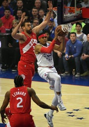 Philadelphia 76ers forward Tobias Harris (33) goes up for a shot as Toronto Raptors center Marc Gasol (33) defends during the first quarter in game six.