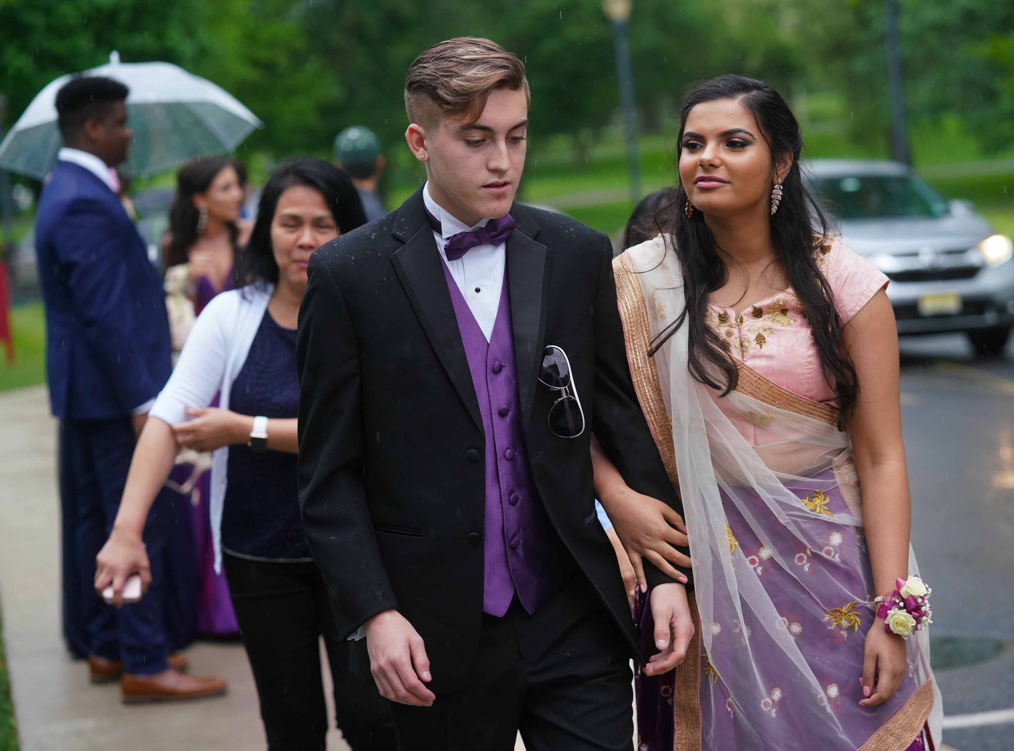 Students and guests from MOT Charter High School in Middletown arrive at Deerfield Country Club for the school's prom, Friday, May 10, 2019.