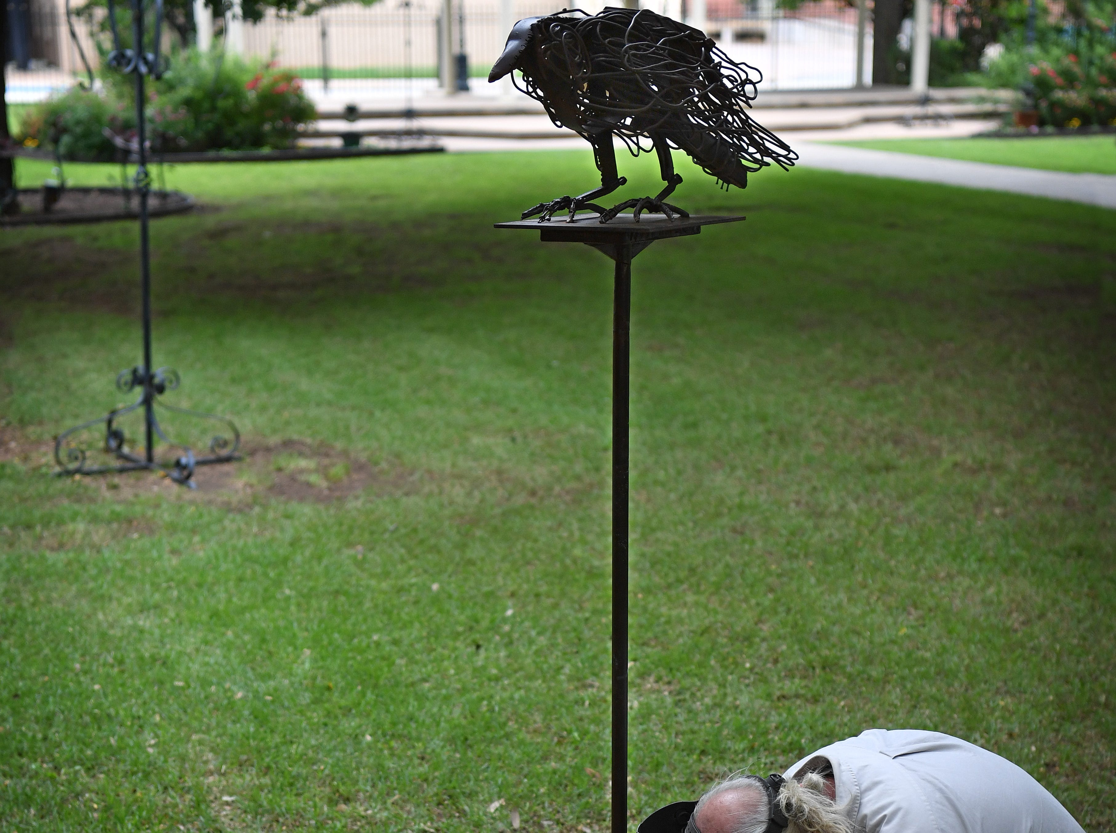 "Sculpture installer Joe Barrington secures the installation of a piece by artist Robert Wilson of Corrales, New Mexico. The sculpture, ""Big Crow"", is made of burnt wood and welded scrap steel."