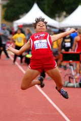 Knox City's Mona Hacker jumps in the 1A girls triple jump in the UIL state track meet Friday, May 10, 2019, in Austin.