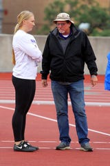 Jacksboro's Baylee Thompson talks with a coach at the UIL state track meet Friday, May 10, 2019, in Austin.