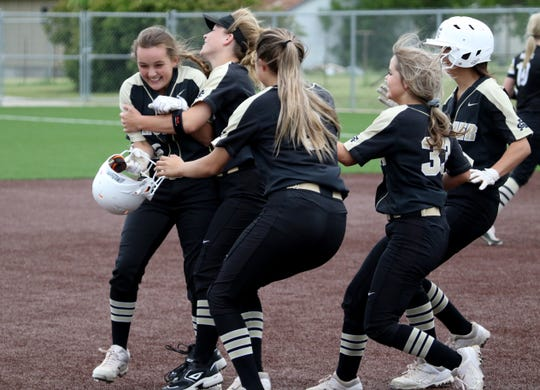 Archer City's Aspyn Huseman is hugged by her teammates after driving in the winning runs against Haskell Thursday, May 9, 2019, in Graford.