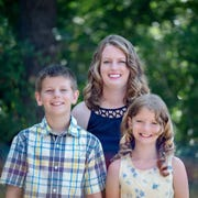 Angela Perry, shown with her children, left to right, Braycen, 12, and Haygen, 10, graduates from MSU Texas Saturday after the single mom and 2007 graduate of Iowa Park High School was determined to finish.