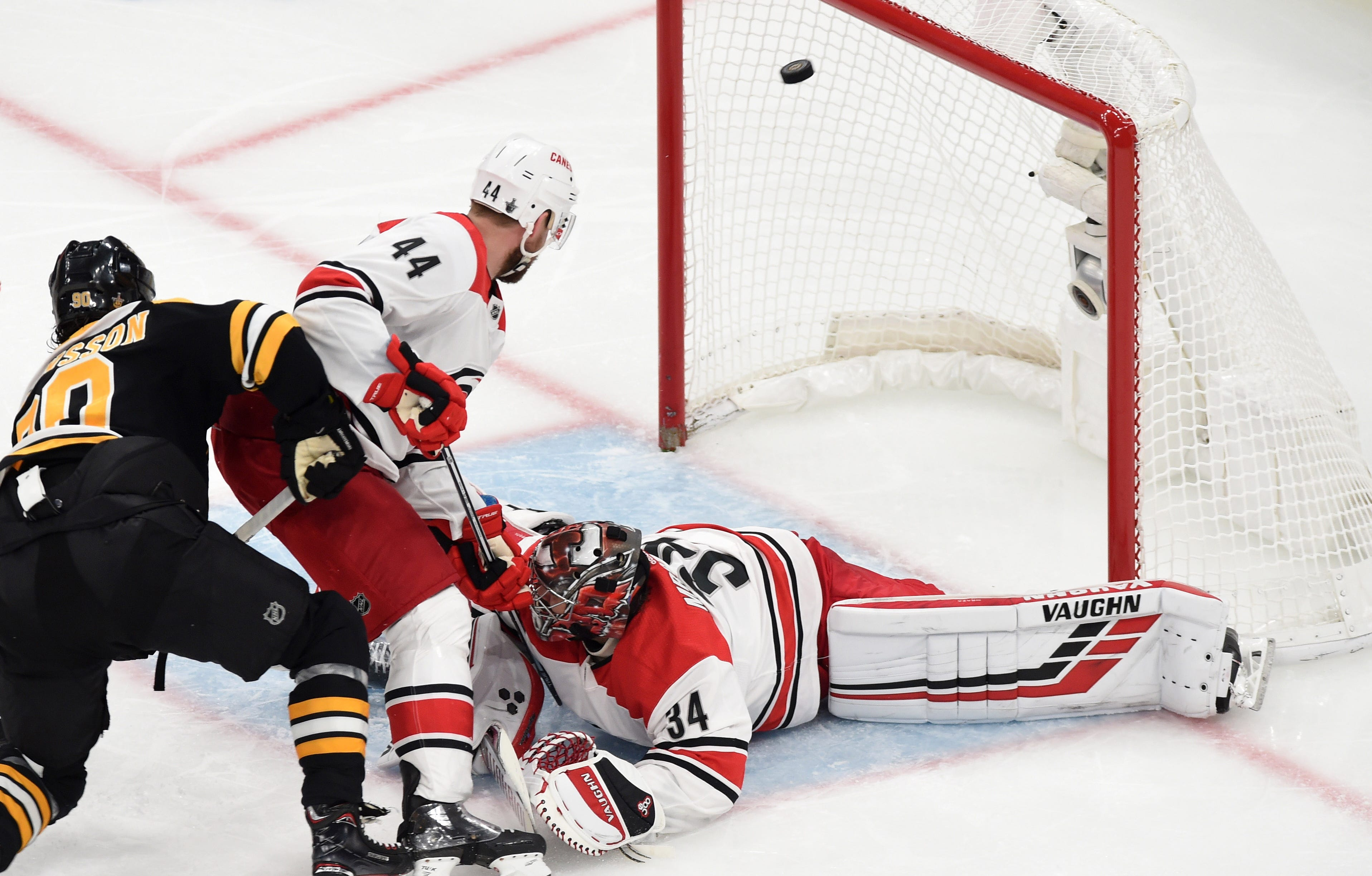 Conference finals: Marcus Johansson scores the first of the Bruins' two power-play goals against Hurricanes goalie Petr Mrazek.