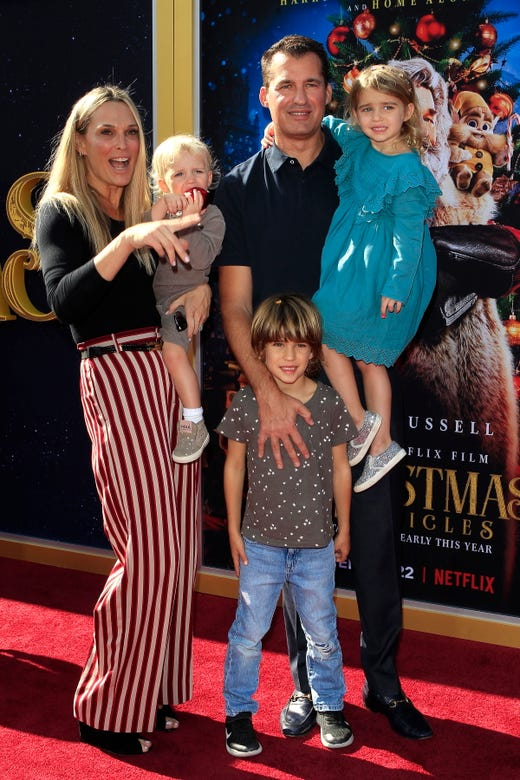 Molly Sims, son Grey Douglas Stuber, daughter Scarlett May Stuber, son Brooks Alan Stuber, and husband Scott Stuber arrive for The Christmas Chronicles' premiere at the Bruin Theater in Westwood, Los Angeles on Nov, 18, 2018.