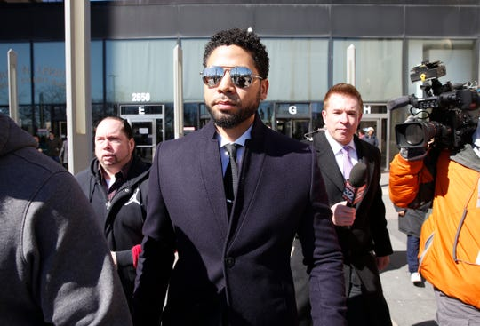 Jussie Smollett leaves the courthouse in Chicago after charges of lying to police were dropped on March 26, 2019.