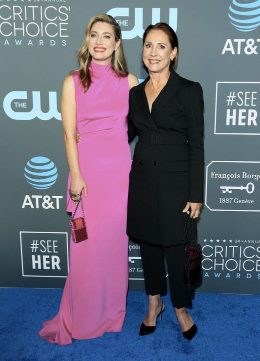 Laurie Metcalf, left, and her daughter actress Zoe Perry arrive for the 24th Critics' Choice Awards at Barker Hangar Santa Monica airport on Jan. 13, 2019, in Santa Monica, Calif.