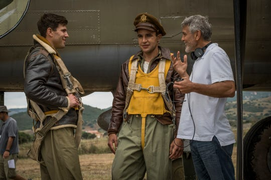 "Austin Stowell and Christopher Abbott take direction from George Clooney in a scene from Hulu's ""Catch-22."""