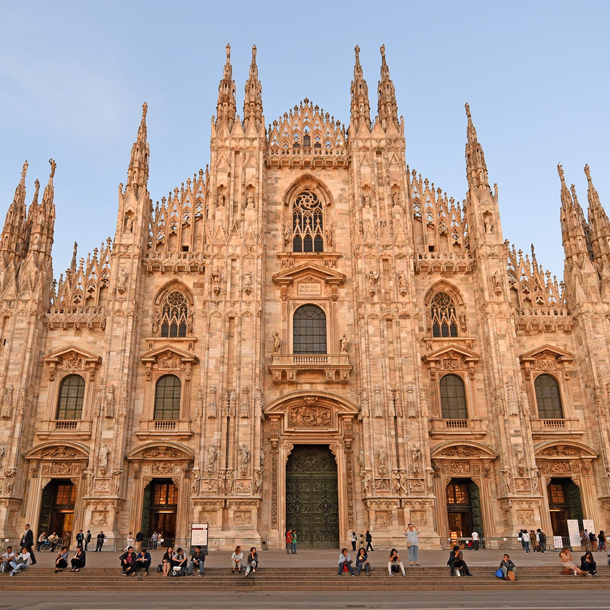 Made of pink marble and decorated with Gothic spires, Milan's cathedral is one of the largest in Europe.