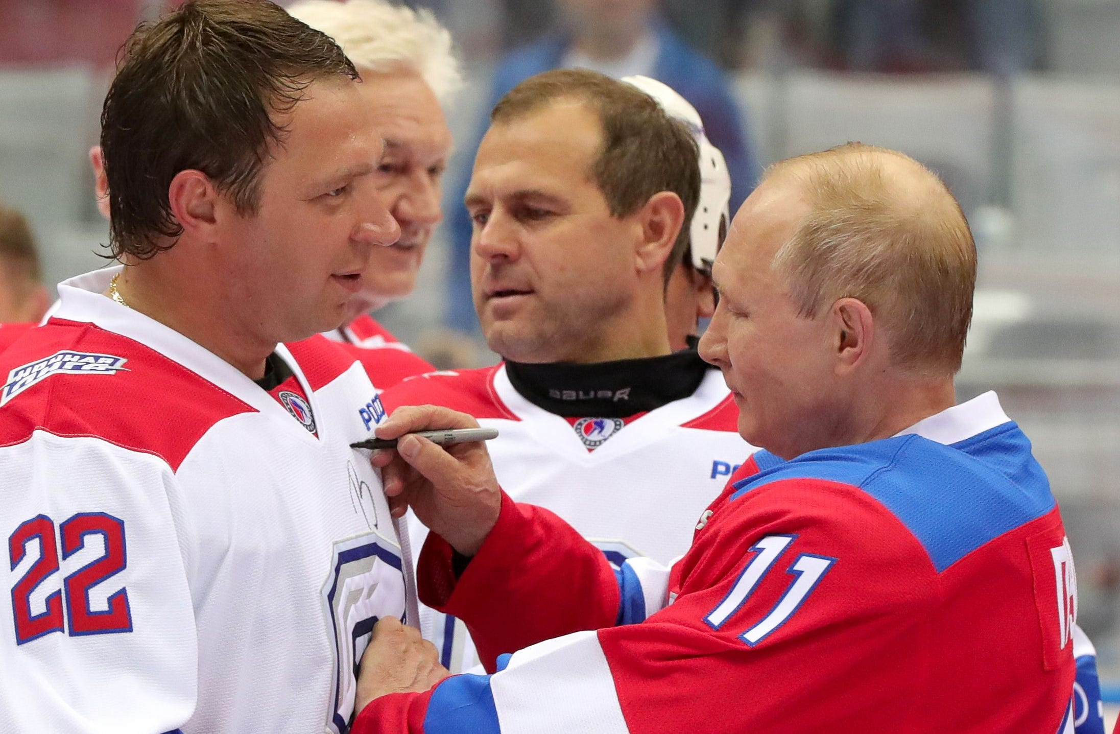 Russian President Vladimir Putin signs an autograph after the Night Ice Hockey League gala at the Bolshoy Ice Dome in Sochi, Russia.