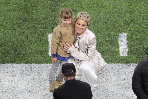 Pink and her daughter Willow Sage Hart stand on the field prior to the game between the Philadelphia Eagles and the New England Patriots in Super Bowl LII at U.S. Bank Stadium on Feb. 4, 2018, in Minneapolis.
