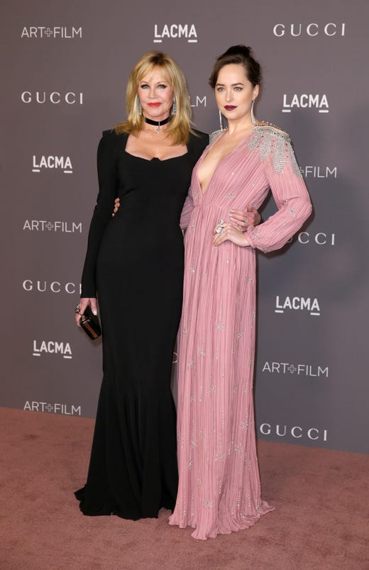 Melanie Griffith, left, and her daughter Dakota Johnson arrive for the LACMA Art + Film Gala at the Los Angeles County Museum of Art in Los Angeles on Nov. 4, 2017.