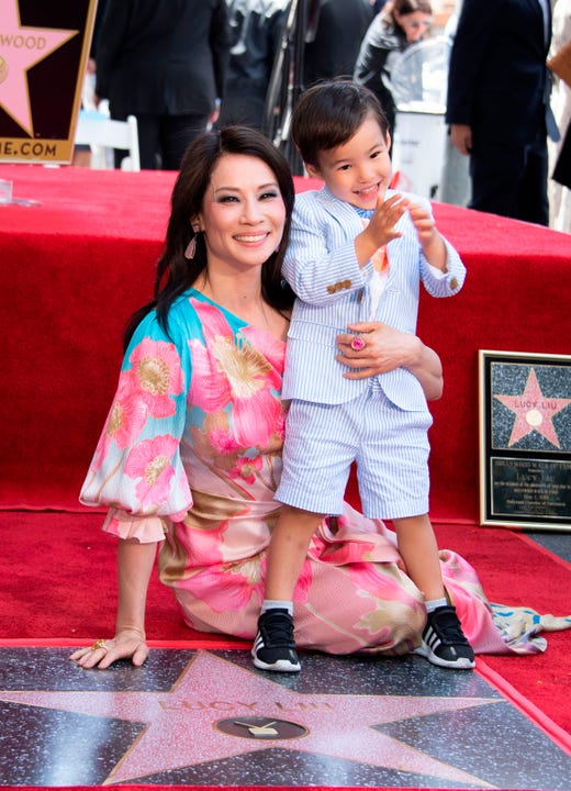 Lucy Liu is joined by her son Rockwell Lloyd as she receives her star on the Walk of Fame during a ceremony in Hollywood on May 1, 2019. Lucy Liu's star is the 2,662nd star on the Hollywood Walk Of Fame in the Category of Television.