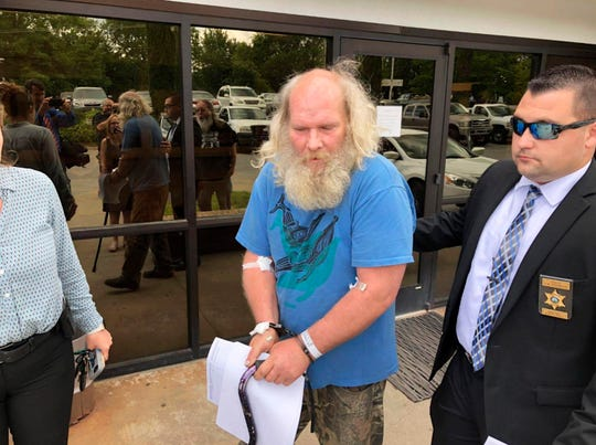 This photo taken from video provided by WSOC-TV shows suspect Edwin Hiatt after his arrest Thursday, May 9, 2019, in Burke County, N.C. Hiatt is charged with bludgeoning and strangling to death a Hollywood TV director more than three decades ago.