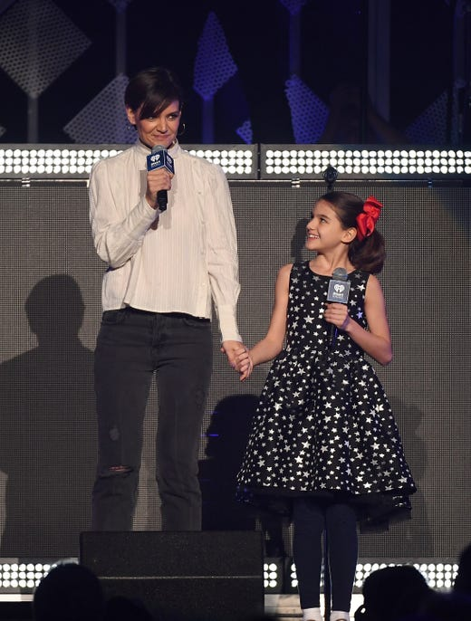 Katie Holmes and her daughter Suri Cruise speak onstage at the Z100's iHeartRadio Jingle Ball 2017 at Madison Square Garden on Dec. 7, 2017, in New York.