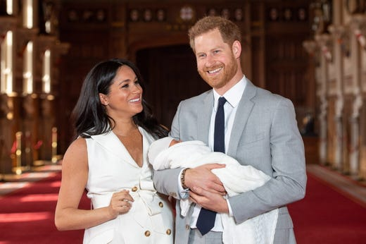 The Duke and Duchess of Sussex with their baby son, Archie, during a photo call in St George's Hall at Windsor Castle in Windsor, Britain on May 8, 2019.