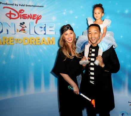Chrissy Teigen, John Legend and daughter Luna attend Disney On Ice Presents Dare to Dream Celebrity Skating Party at Staples Center on Dec. 14, 2018, in Los Angeles.