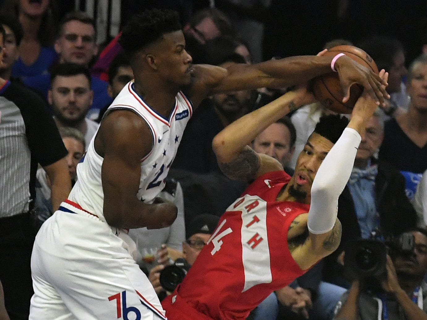 May 9: Sixers defender Jimmy Butler (23) blocks Raptors guard Danny Green (14) during Game 6.