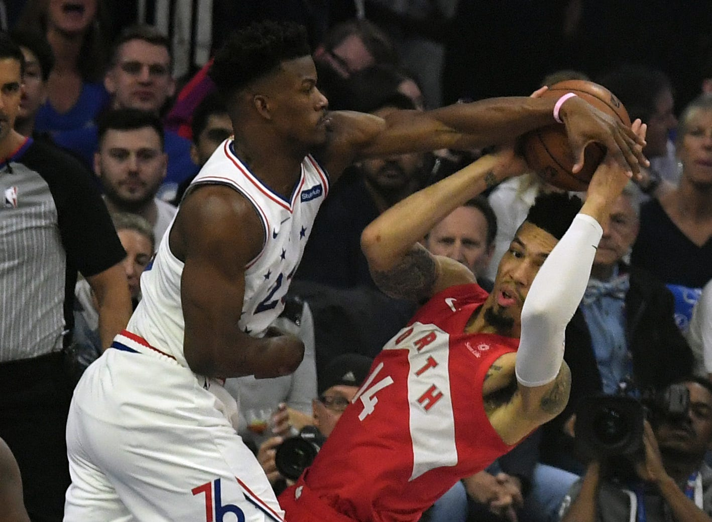 May 9: Sixers defender Jimmy Butler (23) blocks Raptors guard Danny Green (14) during Game 6.