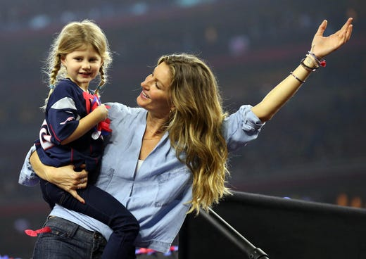 Gisele Bundchen and daughter Vivian Brady celebrate after the New England Patriots beat the Atlanta Falcons during Super Bowl LI at NRG Stadium in Houston on Feb. 5 2017.