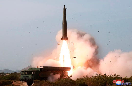 """This May 4, 2019, file photo provided by the North Korean government shows a launch of a missile in the east coast of North Korea. Experts say North Korea's latest launches suggest it may have acquired or cloned a short-range missile the Russian military has long earmarked for export. It's still unclear if the North bought them or built them itself, but experts say the missiles it launched over the past week look just like a nuclear-capable ballistic missile that has long been a source of tension in Europe. Korean language watermark on image as provided by source reads: """"KCNA"""" which is the abbreviation for Korean Central News Agency.  (Korean Central News Agency/Korea News Service via AP, File)"""