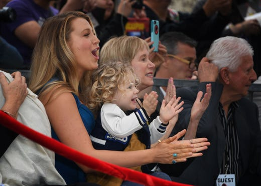 Blake Lively and her daughter James cheer at the Hollywood Walk of Fame ceremony honoring her husband Ryan Reynolds with a star in Hollywood, Calif. on Dec. 15, 2016.