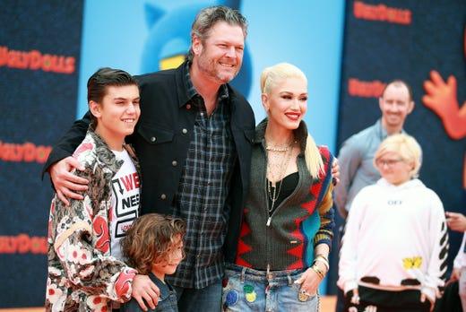 "Kingston Rossdale, left, Apollo Bowie Flynn Rossdale, Blake Shelton, and Gwen Stefani attend STX Films World Premiere of ""UglyDolls"" at Regal Cinemas L.A. Live on April 27, 2019, in Los Angeles."