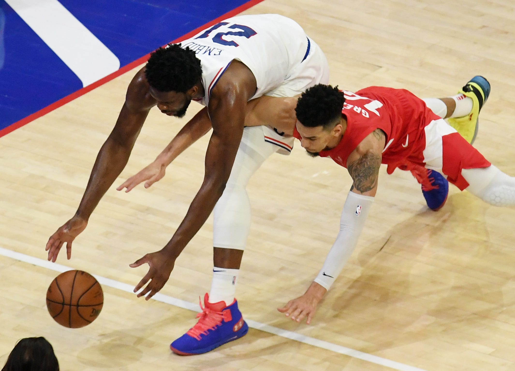 May 9: Sixers center Joel Embiid (21) scrambles for a loose ball against Raptors guard Danny Green (14) during Game 6.