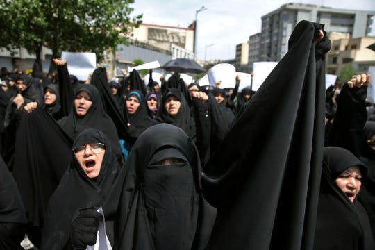 "Worshippers chant slogans against the United States and Israel during a rally after Friday prayers in Tehran, Iran, Friday, May 10, 2019. A top commander in Iran's powerful Revolutionary Guard said Friday that Tehran will not talk with the United States, an Iranian news agency reported — a day after President Donald Trump said he'd like Iranian leaders to ""call me."" (AP Photo/Ebrahim Noroozi) ORG XMIT: ENO105"