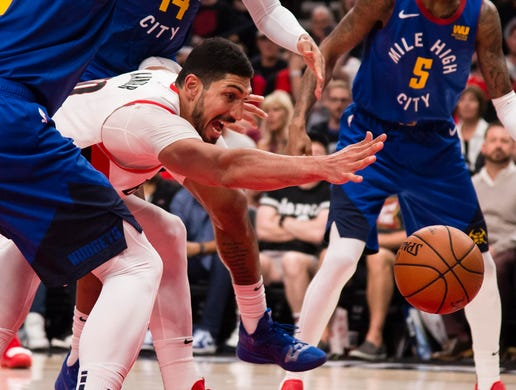 May 9: Blazers center Enes Kanter tries to corral a loose ball during Game 6 against the Nuggets.