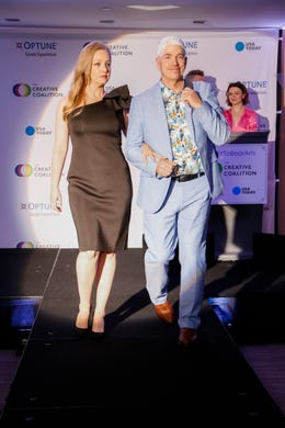 WASHINGTON, DC - MAY 09: Actress Wendi McClendon-Covey and Optune Patient Ambassador Brian Biggs walk the runway during the Creative Coalition's 2019 #RightToBearArts Gala Presented By Optune on May 09, 2019 in Washington, D.C. (Photo by Paul Morigi/Getty Images The Creative Coalition) ORG XMIT: 775330972 ORIG FILE ID: 1148120208