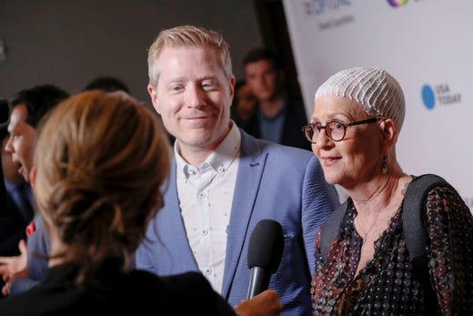 WASHINGTON, DC - MAY 09: (L-R) Actor Anthony Rapp and Optune Patient Ambassador Lynn Oxenberg speak to media at the Creative Coalition's 2019 #RightToBearArts Gala Presented By Optune on May 09, 2019 in Washington, D.C. (Photo by Paul Morigi/Getty Images The Creative Coalition) ORG XMIT: 775330972 ORIG FILE ID: 1148120121