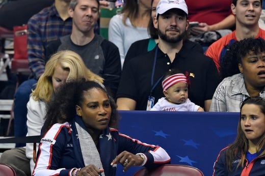 Serena Williams of Team USA along with her husband Alexis Ohanian and their daughter Alexis Olympia, center, watch the action during the first round of the 2018 Fed Cup at U.S. Cellular Center on Feb. 10, 2018, in Asheville, N.C.
