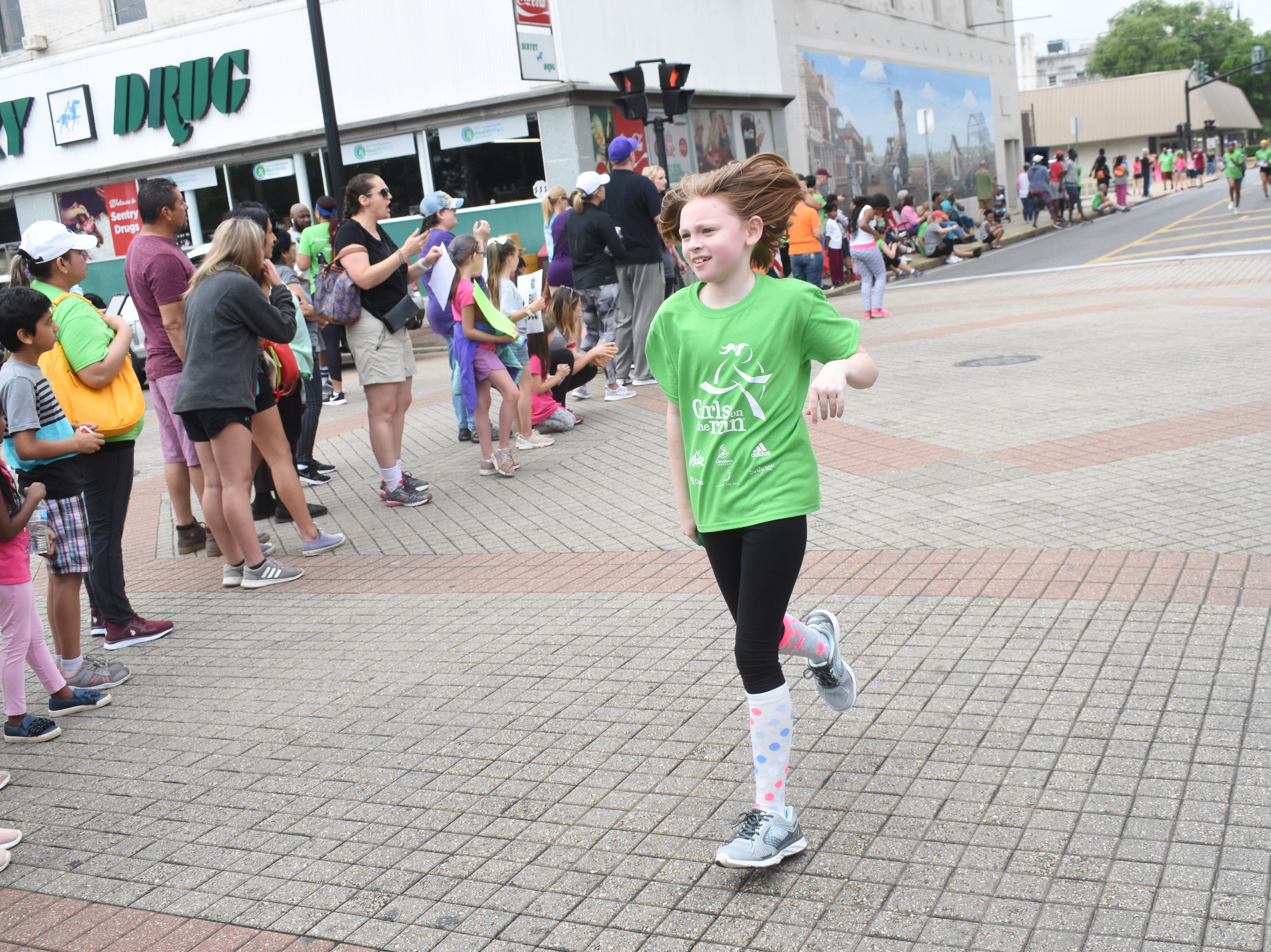 The Spring Girls on the Run 5K was held Saturday, May 11, 2019 in downtown Alexandria. About 260 girls from 17 schools in Central Louisiana participated. Girls on the Run  is an empowerment program for girls in grades third through eighth.The six-week program, which is part of the YWCA, is conducted at the schools and teaches girls life skills for health, friendship and being upstanding members of the community. They are also  taught self confidence. The program culminates in a 5K in which community volunteers run with each girl.
