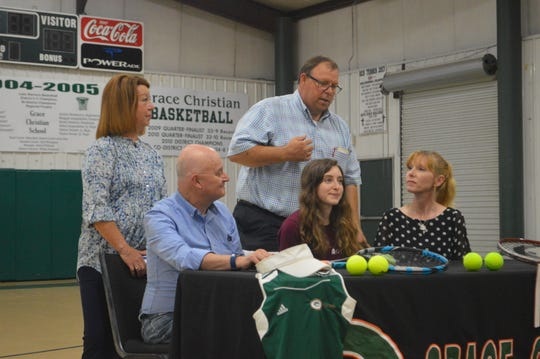 Grace Christian senior Remi Miller (bottom row, center) signed with Centenary College Thursday.